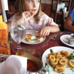 Mina eating calamari
