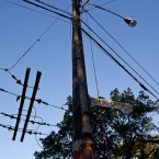 A closer view of the damage, broken pole