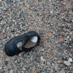 Baby shoe in the junk yard