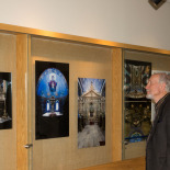 Sezgin inspecting the photographs