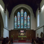 The stained glass windows above the altar
