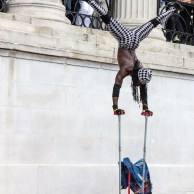 Street performer, hand-stand, upside down, right-side up