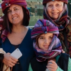 Elif, Mina, and Nana trying out head gear at the Acropolis