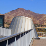 View fom the roof garden with an aluminum structure resembling the mountains