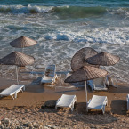 Beach chairs and umbrellas under water