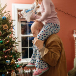 Putting on the tree top angel with Dede-Lift