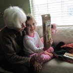 Mina checking out the stocking with Nana