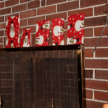 Santa put boxes on the fireplace screen
