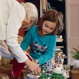 Nana helps Mina to empty the stocking filled by Santa