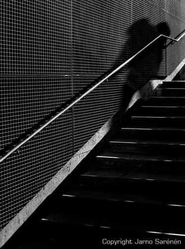 Stairs going up the shadow coming down