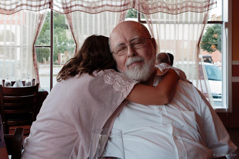 Enjoying a hug from Mamina