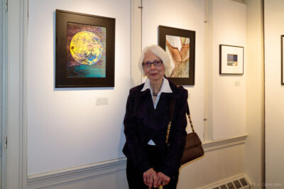 Jan in front of her photographs