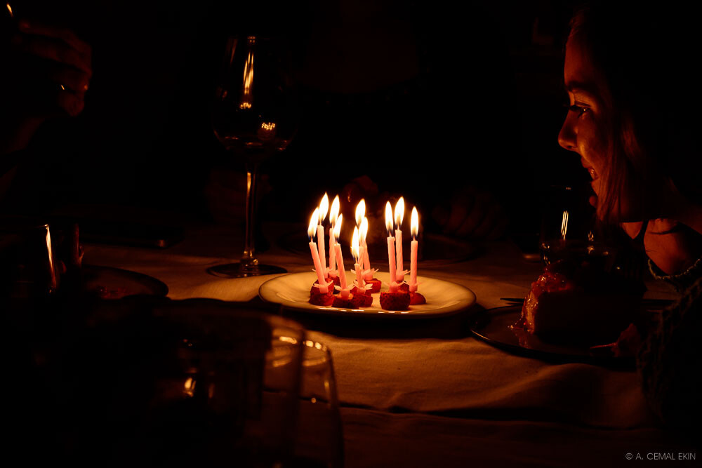 In candle light, Mina's birthday dinner at Ayna (mirror)