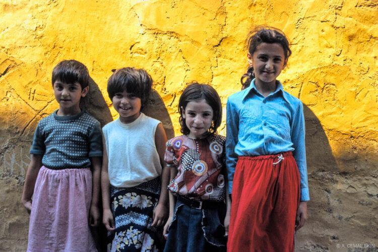 Girls in front of the wall of Aya Yorgi Church in Balat