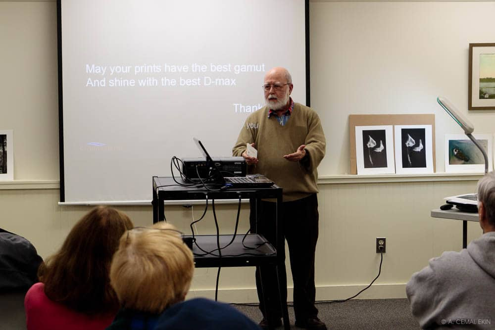 Cemal speaking at a photo club